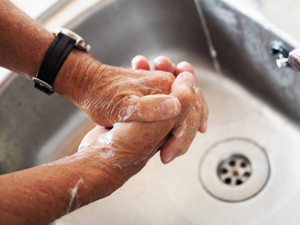 cleaning hands to prevent surgical wounds